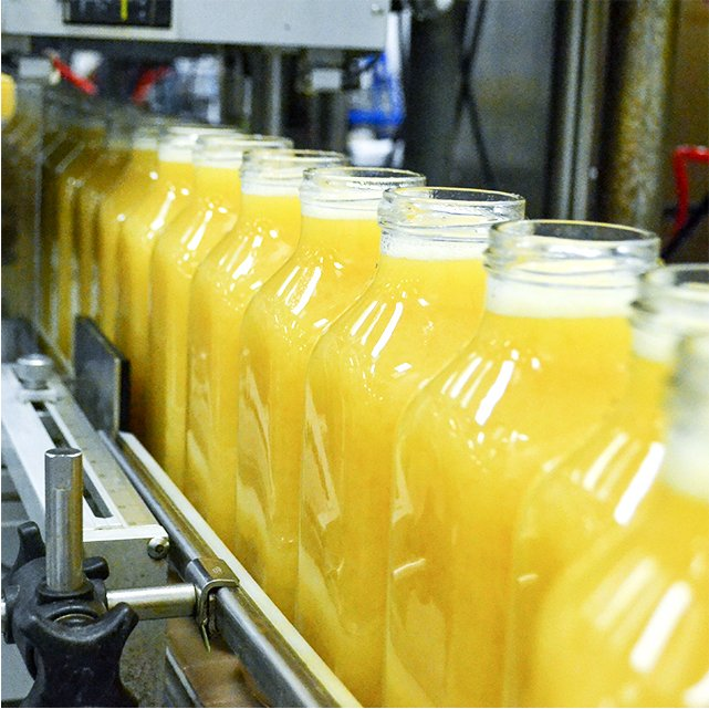 Bottles being filled with Black River fresh orange juice